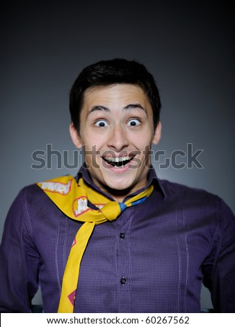 Expressions Handsome business man in funny shirt and tie surprise and laughing - stock photo