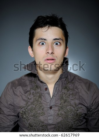 Expressions. Handsome man is terrified and feeling fear . open mouth - stock photo