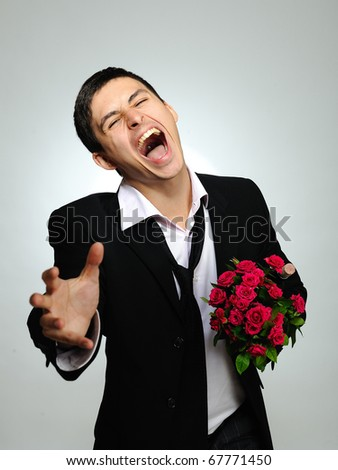 Expressions. screaming husband holding rose flower and vine bottle prepared for a date. gray background
