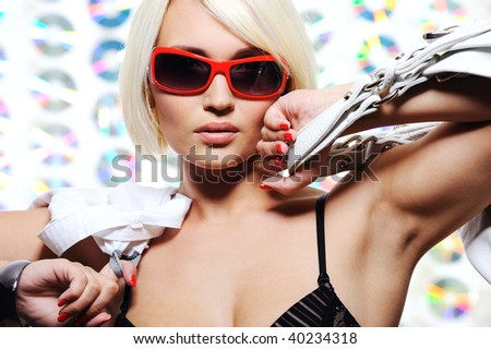 expressive beautiful young trendy woman - colored background