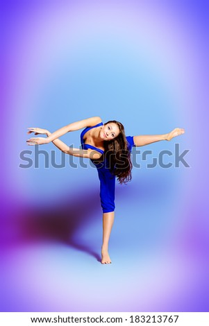 Expressive bellet dancer dancing at studio.