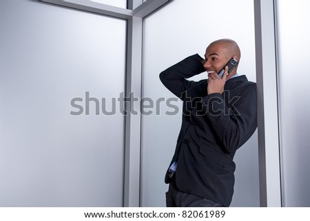 Expressive businessman talking on his cell phone, happy and excited.