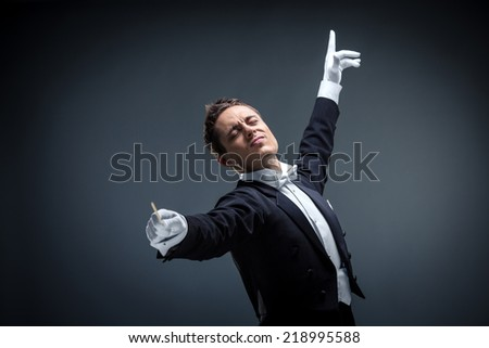 Expressive conductor on a dark background