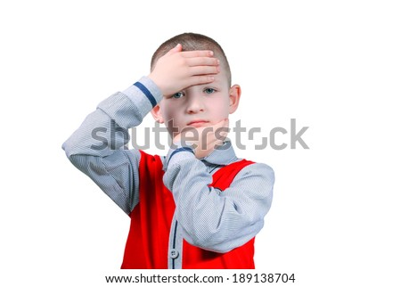 expressive face boy wearing a red shirt in strips - stock photo