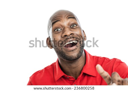 Expressive handsome black man with mouth open surprised isolated on a white background