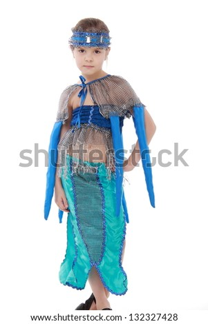 Expressive little girl dressed in a blue costume and dance