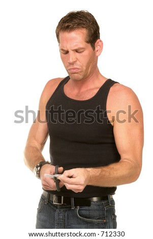 expressive man cutting up credit card