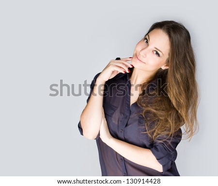 Expressive portrait of a beautiful young brunette woman. - stock photo