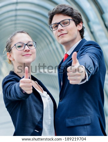 expressive portrait of junior executives of company thumb up - stock photo