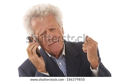 Expressive senior businessman on the phone isolated on white clenched fists - stock photo