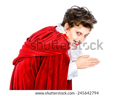 Expressive teen boy in a costume of vampire posing over white background.  Halloween. Isolated. - stock photo