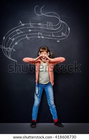 Expressive teen girl enjoys singing a song. Generation. Studio shot. - stock photo