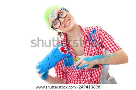Expressive woman holding paint roller over white background