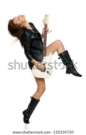Expressive woman playing the guitar in full length over white background - stock photo