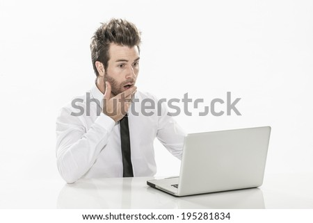 expressive young businessman working on his laptop