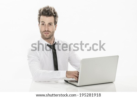 expressive young businessman working on his laptop - stock photo