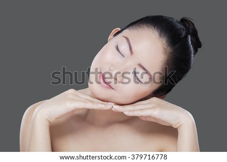 Expressive young chinese model enjoy leisure time after pampering her skin - stock photo