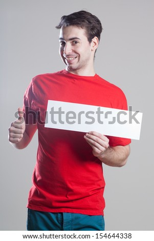 Expressive young man holding a blank board - stock photo