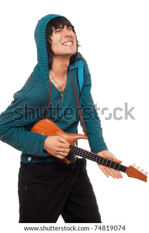 Expressive young man with a little guitar - stock photo