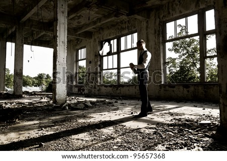 Expressive young man with bottle - stock photo