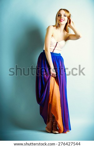 Expressive young model on blue background