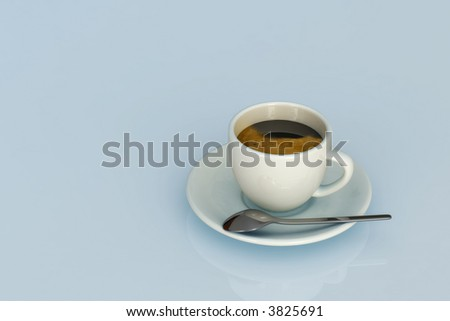 Expresso cup  over a light blue background.