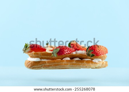 exquisite cream dessert eclair with fresh strawberry