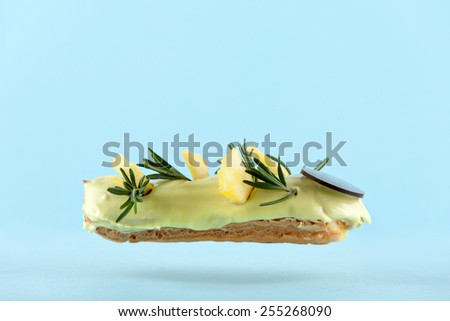 exquisite cream dessert eclair with slices of  fresh pineapple