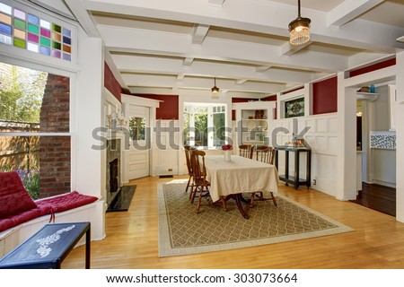 Exquisite dinning room with autumn colored decor, and white table cloth.