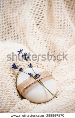 Exquisite natural soap garnished with twigs of lavender - stock photo