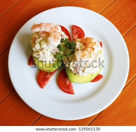 Exquisite seafood stuffed avocado with shrimp - stock photo