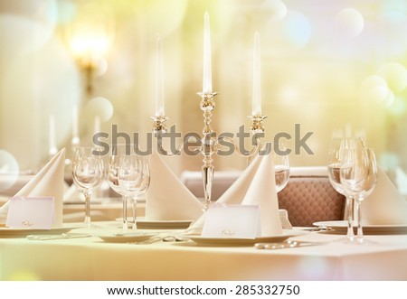 Exquisitely decorated wedding table with invitation cards - stock photo