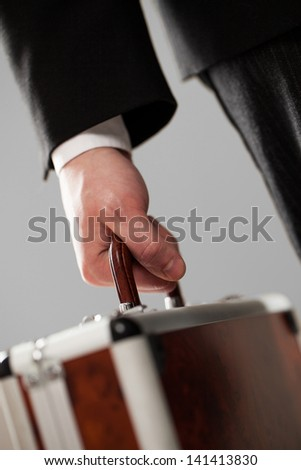 Exrensive document case in businessman hands