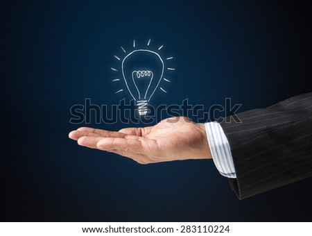 Extended arm of a businessman with a floating bulb icon. Concept image for idea, creativity, genius - stock photo