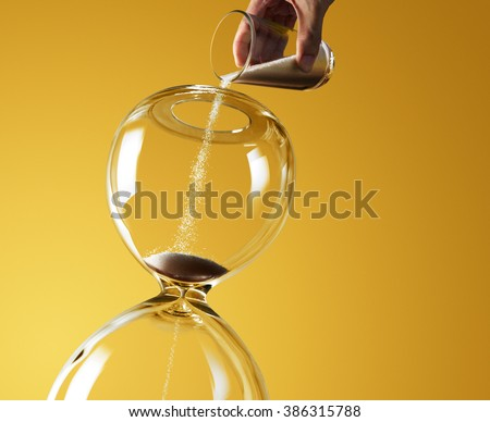 Extended deadline represented by pouring more sand into hourglass
