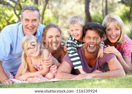 Extended Family Group Relaxing In Park Together - stock photo