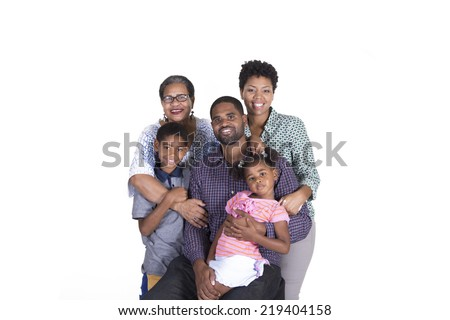 Extended family of grandmother, parents and grandchildren smiling isolated on a white background