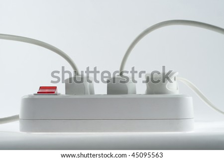 Extension cord with plugs isolated on white - stock photo