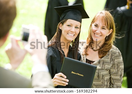 Extensive series of recent student graduates after graduation, outside with friends.  Muti-ethnic group includes parents as well. - stock photo