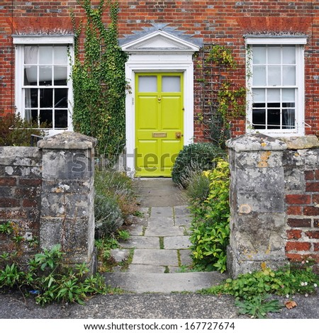 Exterior and Entrance of a Beautiful Georgian Era Red Brick Town House - stock photo
