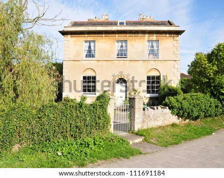 Exterior and Garden of a Detached House in the English Georgian Architectural Style - stock photo