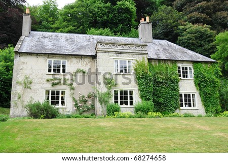 Exterior and Garden of a Typical English Country House Built Circa 1790 - stock photo
