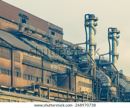 Exterior building of heavy steel industry factory - stock photo