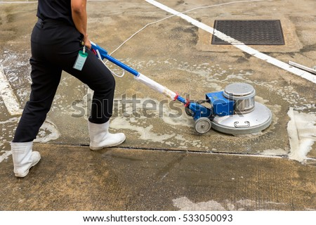 Floor scrub stock images royalty free images vectors for Best chemical to clean concrete