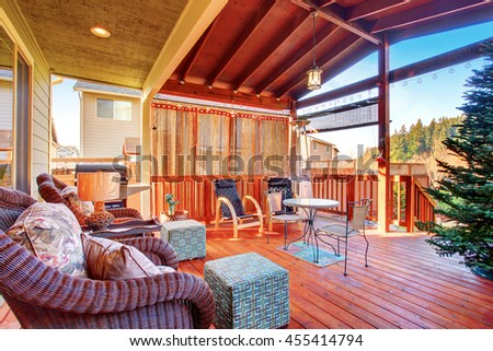 Exterior covered patio with furniture. Wood ceiling with skylights.