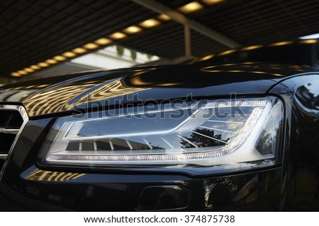 Exterior Detail of Car Headlight - stock photo