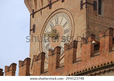 Exterior detail of the Clock Tower at Palazzo Comunale in Bologna, Italy. - stock photo