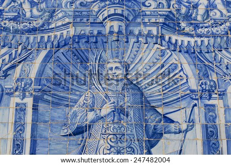 Exterior detail of the Saint Lawrence of Rome church in Almancil, Portugal. Church has one of the most beautiful in Portugal hand painted tiles (Azulejo) of the 18th century at the facade. - stock photo