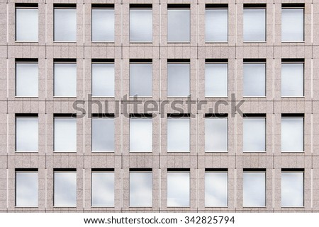 Exterior Glass Windows of a Modern Office Building - stock photo