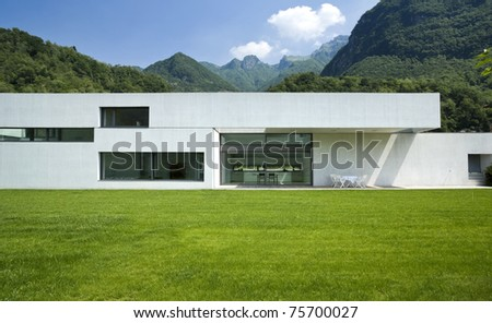 Exterior modern style villa surrounded by nature - stock photo
